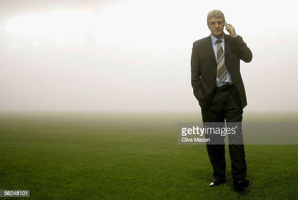Steve Bruce, manager of Birmingham City, walks across the foggy pitch before the Barclays Premiership match between Birmingham City and Bolton...