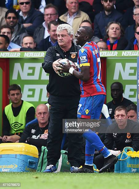 Steve Bruce manager of Hull City and Yannick Bolasie of Crystal Palace struggle for the ball during the Barclays Premier League match between Crystal...