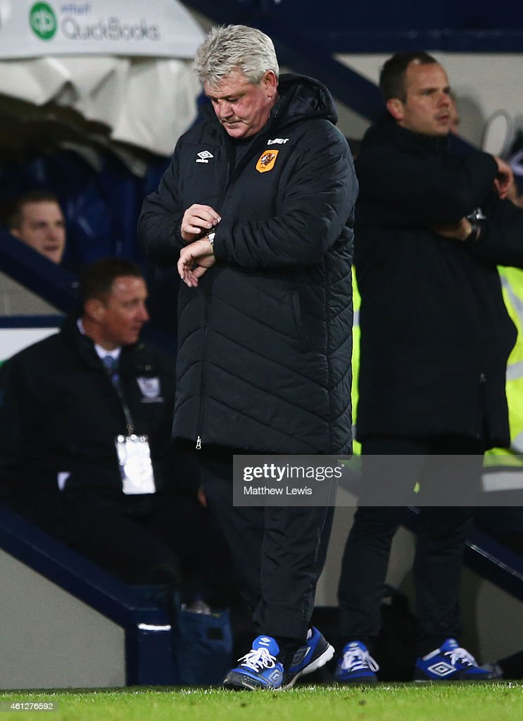 Steve Bruce manager of Hull City checks his watch during the Barclays Premier League match between West Bromwich Albion and Hull City at The Hawthorns on January 10, 2015 in West Bromwich, England.