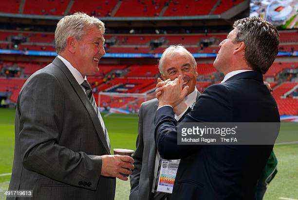 Steve Bruce, manager of Hull City speaks with former player and television presenter Andy Townsend on the pitch before the FA Cup with Budweiser...