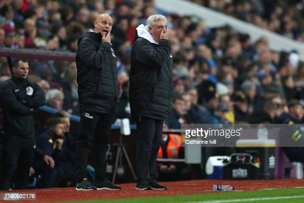 Steve Bruce, Manager of Newcastle United and his Assistant, Steve Agnew during the Premier League match between Aston Villa and Newcastle United at...
