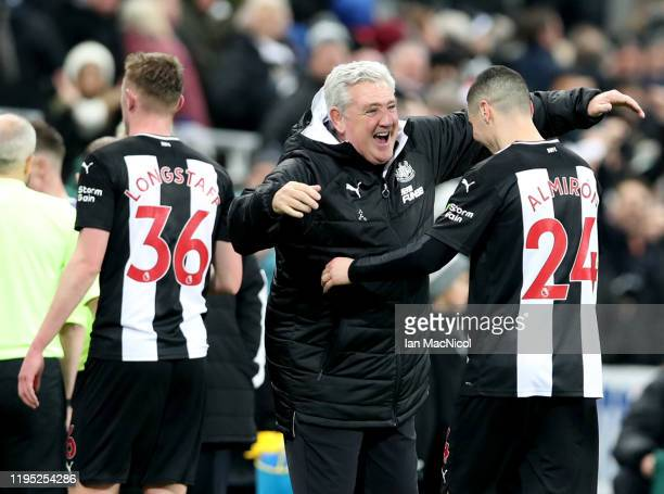 Steve Bruce, Manager of Newcastle United celebrates with Miguel Almiron of Newcastle United following the Premier League match between Newcastle...