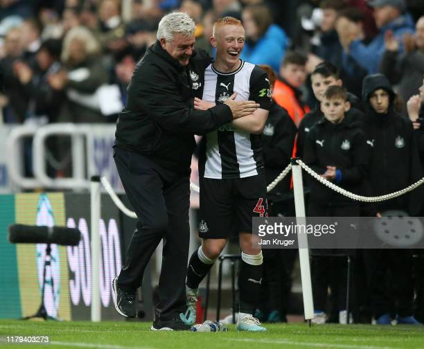 Steve Bruce, Manager of Newcastle United embraces Matthew Longstaff of Newcastle United after the Premier League match between Newcastle United and...