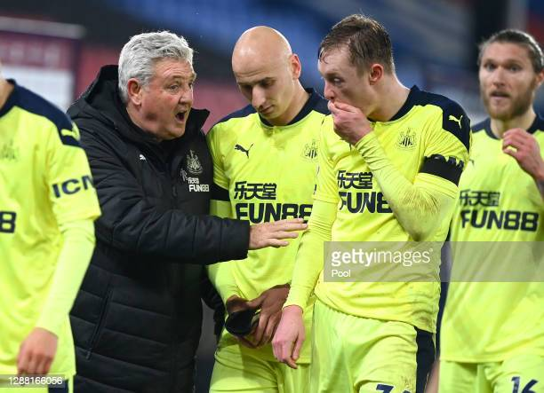 Steve Bruce, Manager of Newcastle United speaks with Jonjo Shelvey and Sean Longstaff of Newcastle United following the Premier League match between...