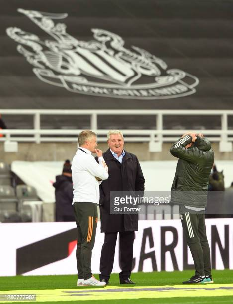 Steve Bruce Manager of Newcastle United speaks with Ole Gunnar Solskjaer Manager of Manchester United prior to the Premier League match between...