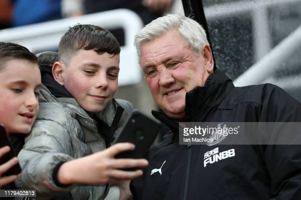 Steve Bruce, Manager of Newcastle United takes a selfie with a fan prior to the Premier League match between Newcastle United and Manchester United...
