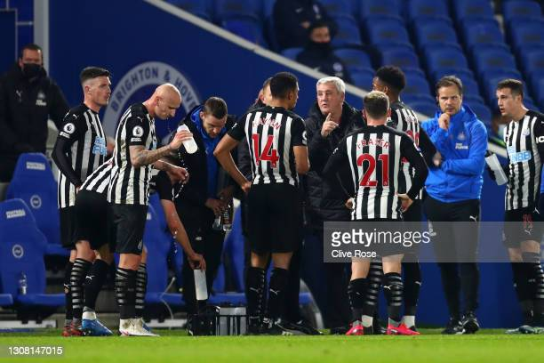 Steve Bruce, Manager of Newcastle United talks to Isaac Hayden and teammates during the Premier League match between Brighton & Hove Albion and...