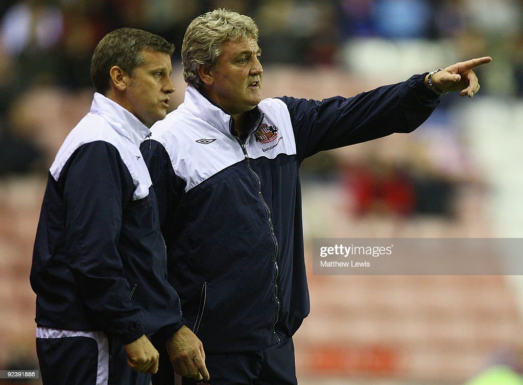 Steve Bruce, manager of Sunderland and Eric Black, Assistant Manager look on during the Carling Cup 4th Round match between Sunderland and Aston Villa at the Stadium of Light on October 27, 2009 in Sunderland, England.