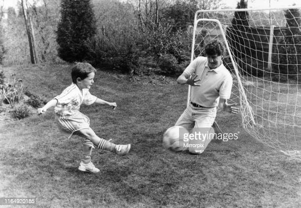 Steve Bruce Manchester United Central Defender playing football at home with son Alex Saturday 20th April 1991