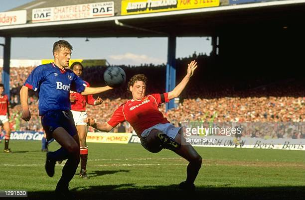 Steve Bruce of Manchester United falls back during the FA Cup SemiFinal against Oldham at Maine Road in Manchester England The match ended in a 33...
