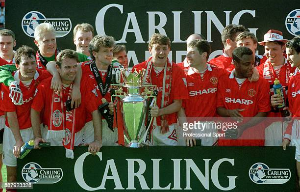 Steve Bruce of Manchester United holding the Premier League Championship trophy as the team pose for a group photograph after their final home game...