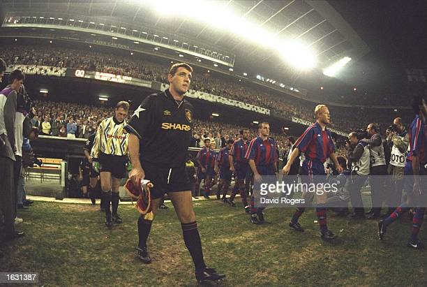 Steve Bruce of Manchester United leads the team onto the pitch before the European Cup match against Barcelona at the Nou Camp Stadium in Barcelona...