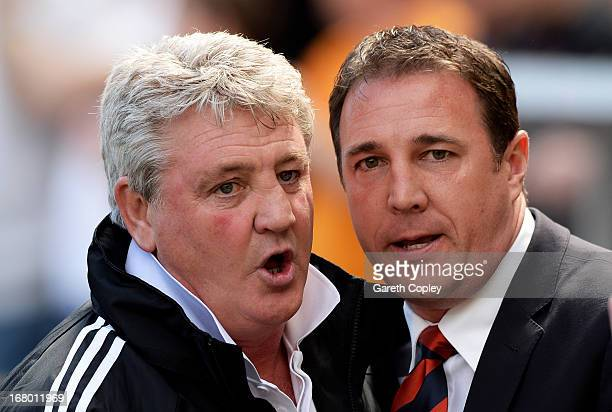 Steve Bruce the Hull manager greets Malky Mackay the Cardiff manager prior to kickoff during the npower Championship match between Hull City and...