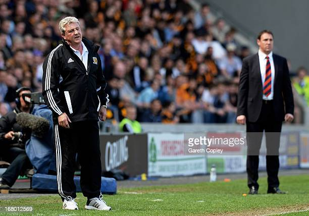 Steve Bruce the Hull manager reacts as Malky MacKay the Cardiff manager looks on during the npower Championship match between Hull City and Cardiff...