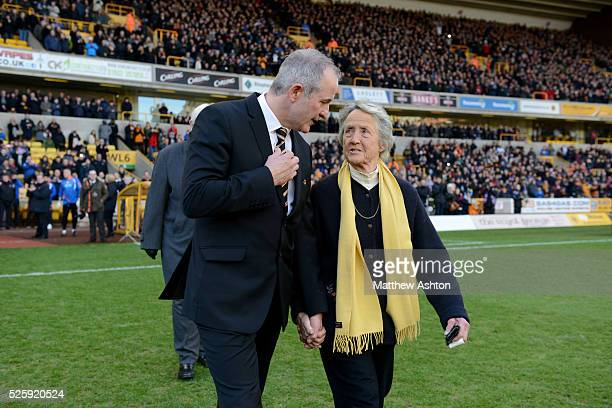 Steve Bull and Rachael HeyhoeFlint walk onto the pitch for Sir Jack Hayward tribute