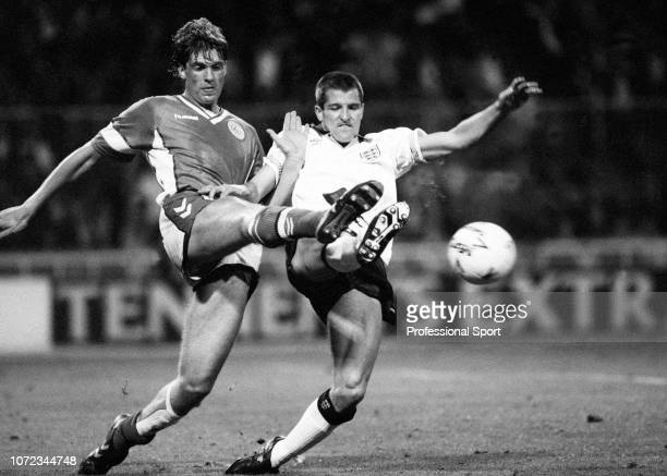 Steve Bull of England and Kent Nielsen of Denmark battle for the ball during an International Friendly match at Wembley Stadium on May 15 1990 in...