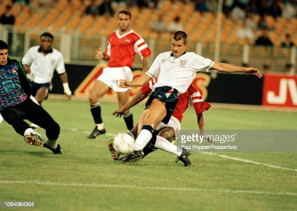 Steve Bull of England has his shot saved by Ahmed Shobair of Egypt during a 1990 FIFA World Cup Group F match at the Stadio Sant'Elia on June 21 1990...