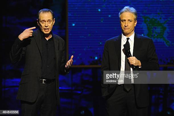 Steve Buscemi and Jon Stewart perform on stage at Comedy Central's 'Night of Too Many Stars America Comes Together For Autism Programs' on February...