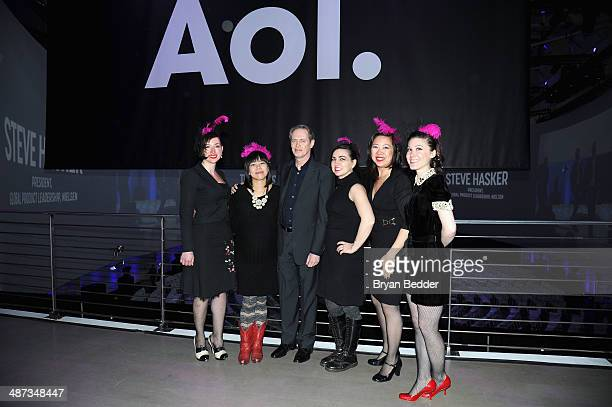 Steve Buscemi poses with members of the Main Squeeze Orchestra at the 2014 AOL NewFronts at Duggal Greenhouse on April 29, 2014 in New York, New York.
