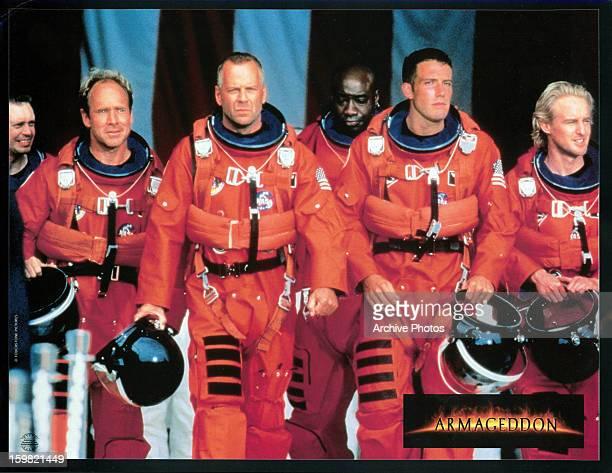 Steve Buscemi Will Patton Bruce Willis Michael Clarke Duncan Ben Affleck and Owen Wilson walking in NASA uniforms in a scene from the film...