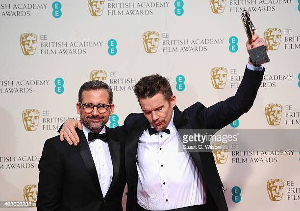Steve Carell and Ethan Hawke who accepted the Best Director award for Richard Linklater for 'Boyhood' pose in the winners room at the EE British...