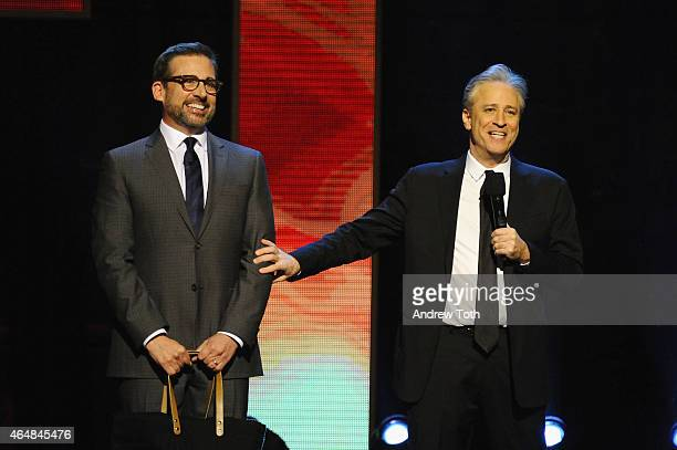 Steve Carell and Jon Stewart perform on stage at Comedy Central's 'Night of Too Many Stars America Comes Together For Autism Programs' on February 28...