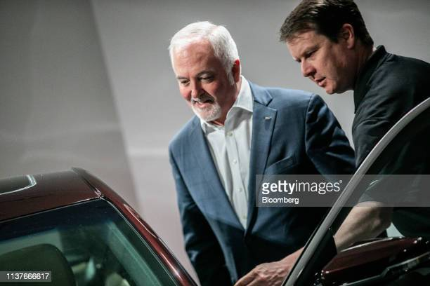 Steve Carlisle president of Cadillac at General Motors Co left looks inside a Cadillac CT5 during an event in New York US on Tuesday April 16 2019...