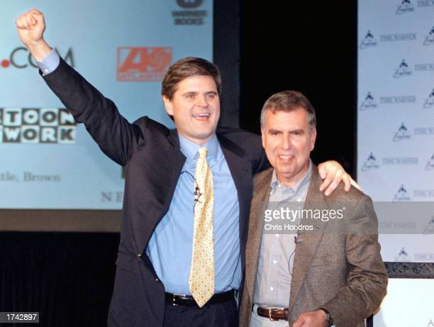 Steve Case Chairman and CEO of America Online left and Gerald Levin Chairman and CEO of Time Warner right hug on Monday January 10 2000 in New York...