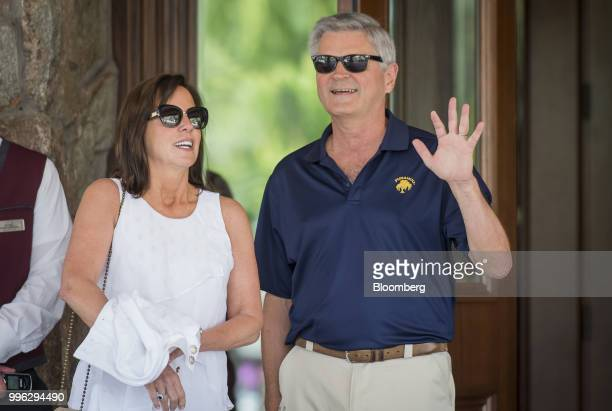 Steve Case chairman and chief executive officer of Revolution LLC right and his wife Jean Case chief executive officer of Case Foundation arrive for...