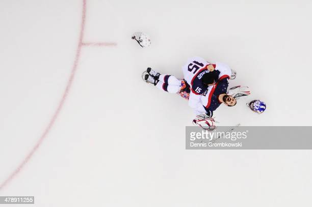 Steve Cash of the United States celebrates winning the gold medal with Nikko Landeros after the Ice Sledge Hockey Gold Medal game between the United...