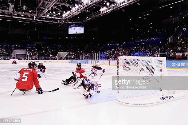 Steve Cash of the United States stretches for the puck during the Ice Sledge Hockey Play-off semi final between Canada and the United States of...