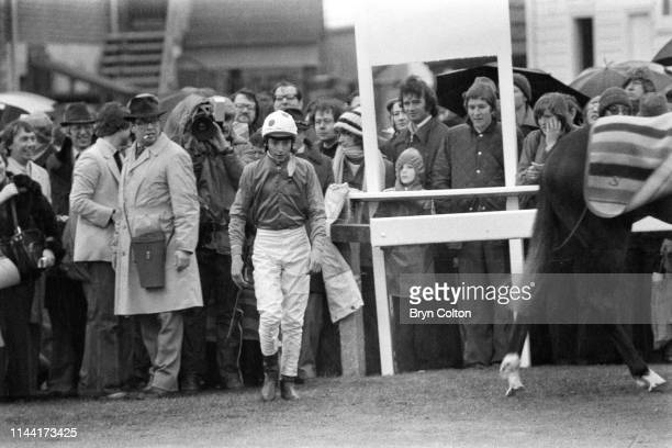 Steve Cauthen an American jockey aged 18 entires the parade ring during his first horse race in the United Kingdom at Salisbury Racecourse in...