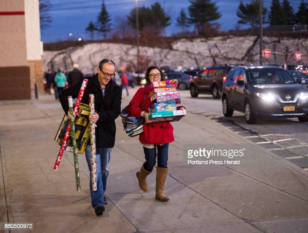 Steve Chapman of Saco and Nina Labrie of North Attleboro MA walk to their car after early Black Friday shopping at Target