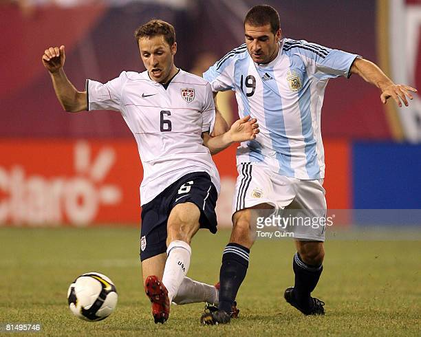 Steve Cherundolo of USA moves in front of Lisandro Lopez during an international friendly match that ended in a 00 tie at Giants Stadium on June 8...