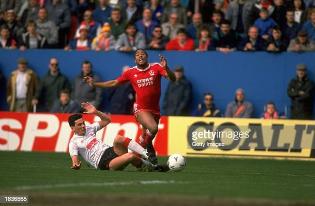 Steve Chettle of Nottingham Forest fouls John Barnes of Liverpool for a penalty during the FA Cup Semi-Final at Hillsborough in Sheffield, England....