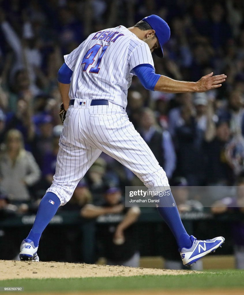 Steve Cishek #41 of the Chicago Cubs celebrates after getting a save against the Colorado Rockies at Wrigley Field on April 30, 2018 in Chicago, Illinois. The Cubs defeated the Rockies 3-2.