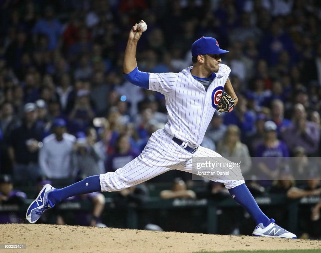 Steve Cishek #41 of the Chicago Cubs pitches in the 9th inning for a save against the Colorado Rockies at Wrigley Field on April 30, 2018 in Chicago, Illinois. The Cubs defeated the Rockies 3-2.