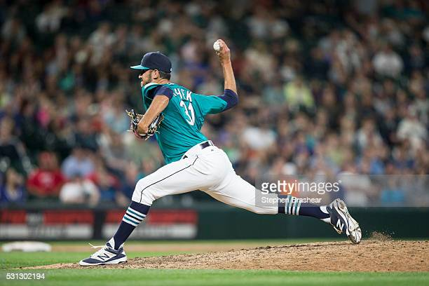 Steve Cishek of the Seattle Mariners delivers a pitch during the ninth inning of a game against the Los Angeles Angels of Anaheim at Safeco Field on...