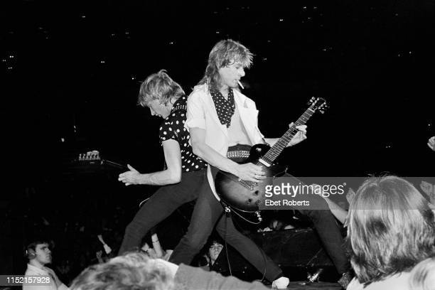 Steve Clark and Phil Collen performing with Def Leppard at the Brendan Byrne Arena in East Rutherford New Jersey on March 27 1983