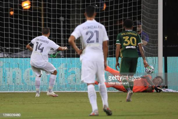Steve Clark of Portland Timbers stops a penalty kick of Javier Hernandez of Los Angeles Galaxy during a match between Los Angeles Galaxy and Portland...