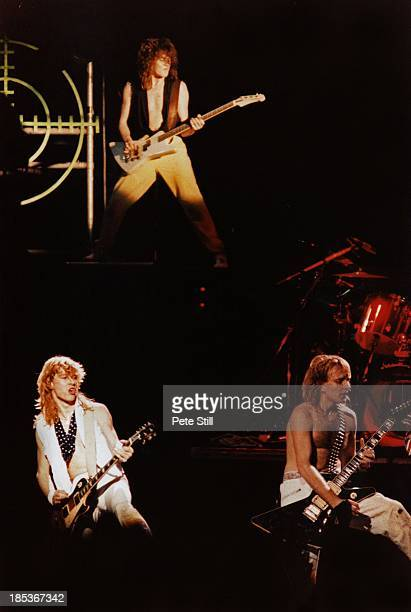 Steve Clark, Rick Savage and Phil Collen of Def Leppard perform on stage at Hammersmith Odeon, on December 5th, 1983 in London, England.