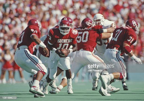 Steve Collins Quarterback for the University of Oklahoma Sooners prepares to hand the ball off during a NCAA Southwest Conference college football...