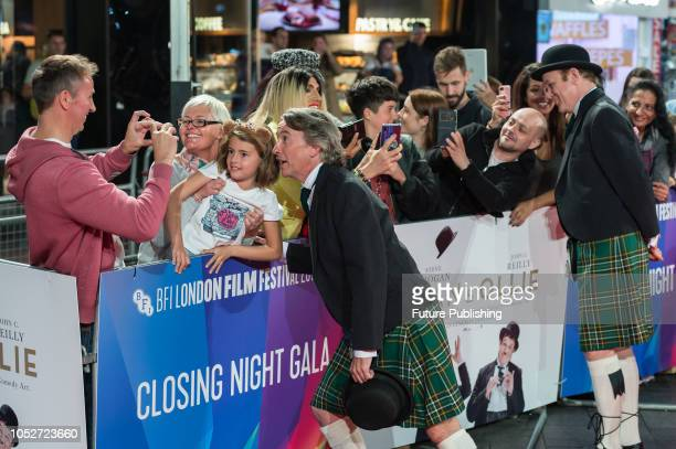 Steve Coogan and John C Reilly pose for fan photos during the World Premiere of 'Stan & Ollie' at Cineworld, Leicester Square, during the 62nd London...
