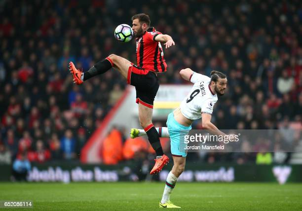 Steve Cook of AFC Bournemouth and Andy Carroll of West Ham United battle to win a header during the Premier League match between AFC Bournemouth and...