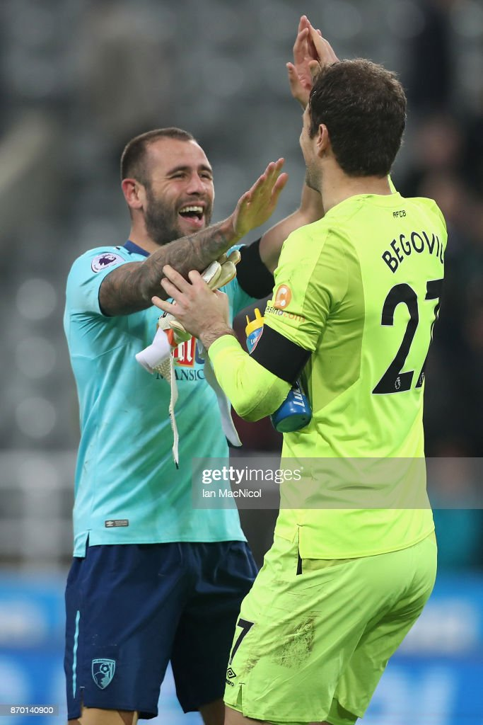 Steve Cook of AFC Bournemouth and Asmir Begovic of AFC Bournemouth celebrates after the Premier League match between Newcastle United and AFC Bournemouth at St. James Park on November 4, 2017 in Newcastle upon Tyne, England.