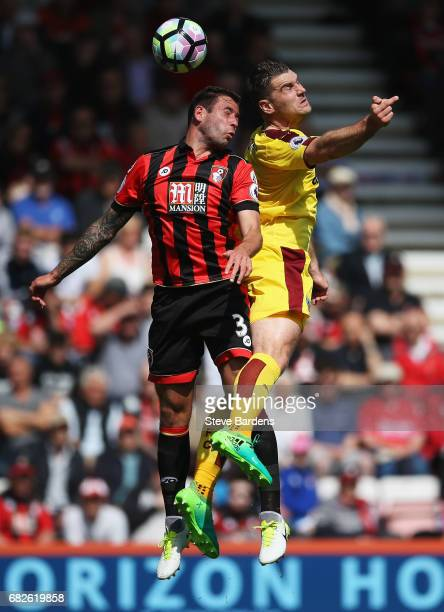 Steve Cook of AFC Bournemouth and Sam Vokes of Burnley battle to win a header during the Premier League match between AFC Bournemouth and Burnley at...