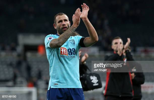 Steve Cook of AFC Bournemouth applauds the travelling support at the final whistle during the Premier League match between Newcastle United and AFC...