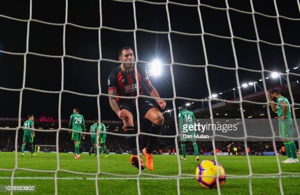 Steve Cook of AFC Bournemouth celebrates as Callum Wilson of AFC Bournemouth scores his teams's second goal during the Premier League match between...
