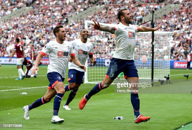 Steve Cook of AFC Bournemouth celebrates scoring his side's second goal with team mates during the Premier League match between West Ham United and...