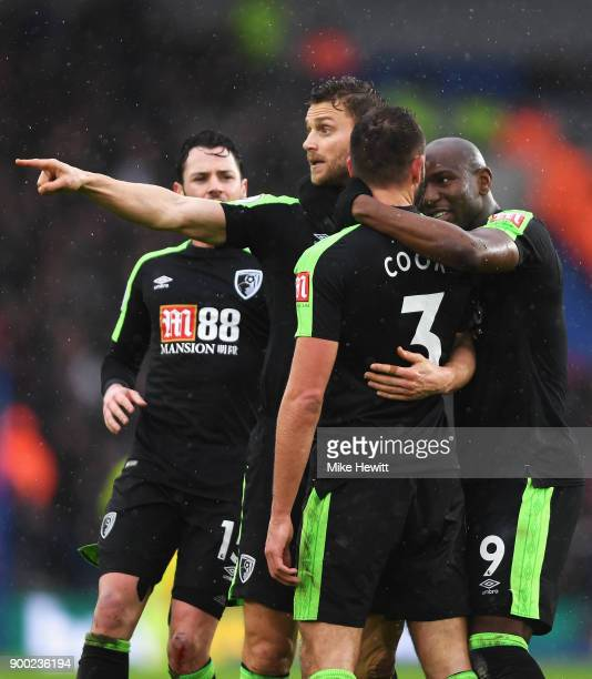Steve Cook of AFC Bournemouth celebrates scoring his team's first goal with team mates including Benik Afobe of AFC Bournemouth during the Premier...